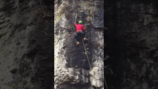 Stas Beskin getting first ascent of new route Bat Yoga